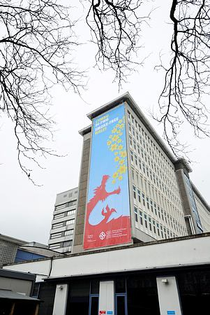 The sign which covers the height of the University Hospital Wales, Cardiff