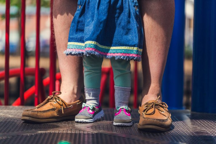 dad-and-daughter-legs-in-playground